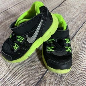 Nike size 5 black and green baby kicks